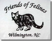 The black and white artwork on the front of the T-shirt. It reads, Friends of Felines - Wilmington, NC and has the picture of a cat.